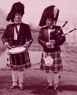 sepia tone image of a Highland bagpiper and a Highland drummer