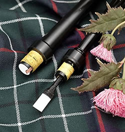 image of bagpipe chanter, tartan and thistle